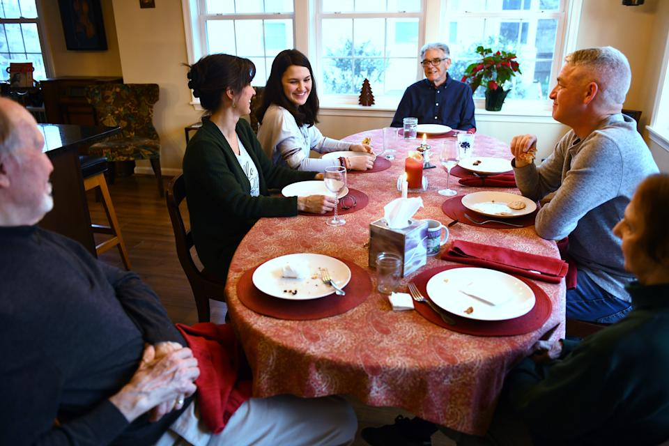 ARLINGTON, VA - MARCH 22: The three generations enjoy nightly meals around the dining room table March 22, 2018 in Arlington, VA. Clockwise from left are Jim Gibbs, Lisa Gibbs-Smith, Lauren Smith, 13, Frank Smith, Rusty Smith and Grace Gibbs. (Photo by Katherine Frey/The Washington Post via Getty Images)