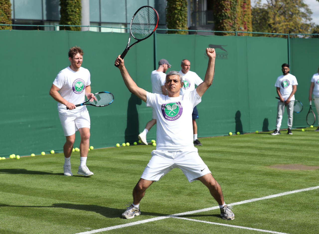 Mayor of London Sadiq Khan plays tennis with key workers at the All England Lawn Tennis Club in Wimbledon, south west London, during an event to thank members of the NHS, TfL and care workers for their service during the coronavirus pandemic.