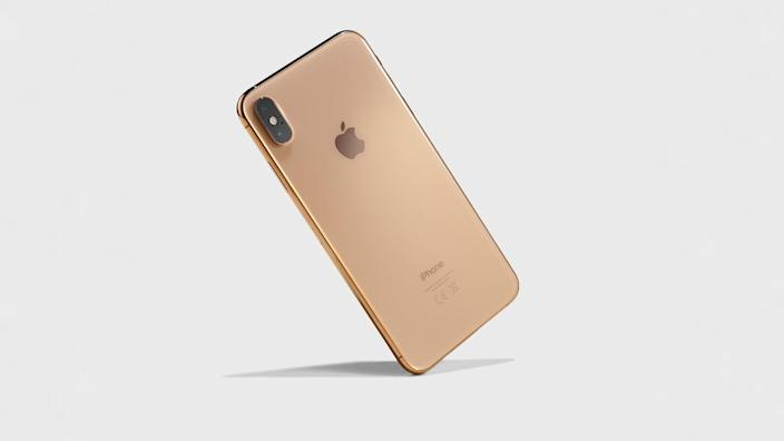 Editorial Use onlyMandatory Credit: Photo by Neil Godwin/Future/Shutterstock (10230403t)An Apple iPhone Xs Max Smartphone With A Gold FinishPremium Two-In-One Laptop Computers - 5 Oct 2018.