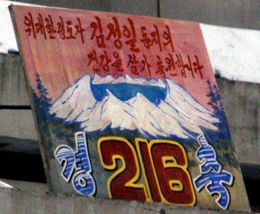 A poster celebrates the birthday of the late North Korean leader Kim Jong-il on Mount Paektu