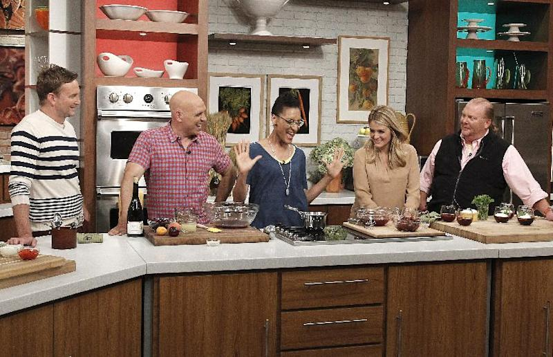 """This June 18, 2013 photo released by ABC shows hosts of """"The Chew,"""" from left, Clinton Kelly, Michael Symon, Carla Hall, Daphne Oz and Mario Batali on the set in New York. When ABC's """"The Chew"""" premiered in September 2011, it begged the question: Was it biting off more than it could chew? Maybe not. On Tuesday in its regular 1 p.m. EST time slot, """"The Chew"""" marks its 500th edition. (AP Photo/ABC, Lou Rocco)"""