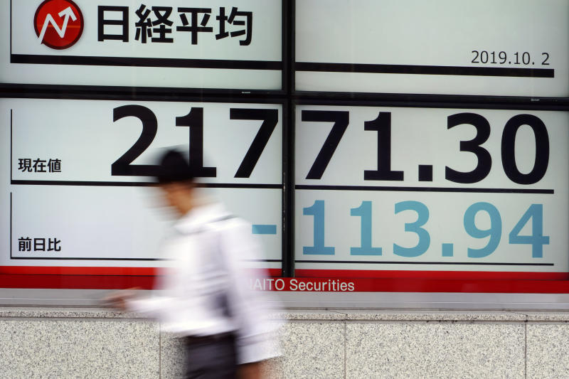A man walks past an electronic stock board showing Japan's Nikkei 225 index at a securities firm in Tokyo Wednesday, Oct. 2, 2019. Asian shares are lower after U.S. stocks posted their worst loss in five weeks on Wednesday after a surprisingly limp report on the nation's manufacturing that stirred worries about the economic outlook.(AP Photo/Eugene Hoshiko)