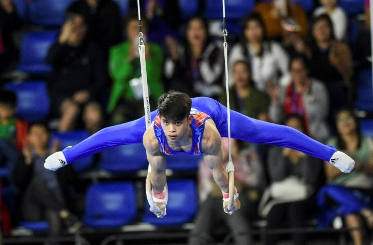 World champion Philippine gymnast Carlos Yulo has taken his tally in the Southeast Asian Games to two golds and five silvers (AFP Photo/TED ALJIBE)