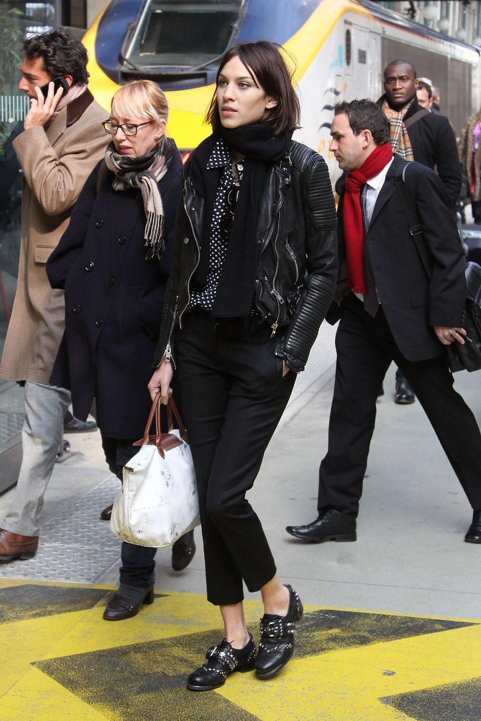 <p>Nothing was as important in your life as your Longchamp tote, because it most likely was your first investment piece—but it was so worth it because it held all your stuff, and you carried it around 24/7. Here, Alexa Chung carried a cat-print version of the bag in Paris. </p>