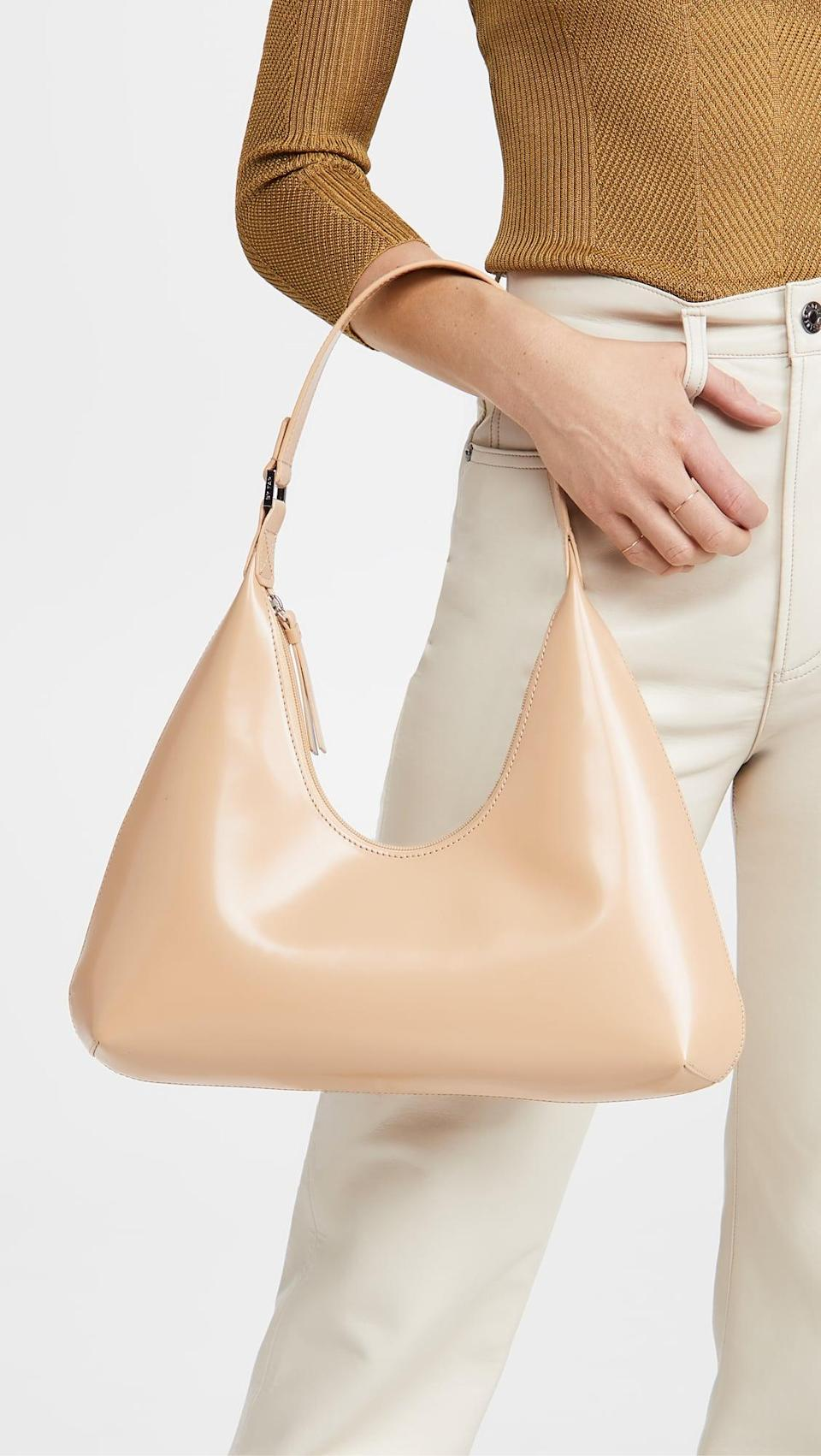 """<p>""""I've been seeing the <span>BY FAR Amber Bag</span> ($634) all over my Instagram feed and am convinced. The chic silhouette is perfect for everyday, and easy to throw on with sweats or jeans. Plus, the cute tan shade will look good with everything this spring and summer."""" - Krista Jones, associate editor, Shop</p>"""