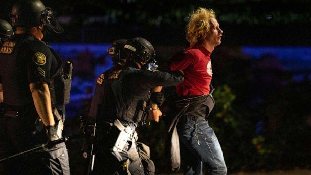 PHOTO: Portland police make arrests on the scene of the nightly protests at a Portland police precinct on Sunday, Aug. 30, 2020 in Portland, Ore. (Paula Bronstein/AP)