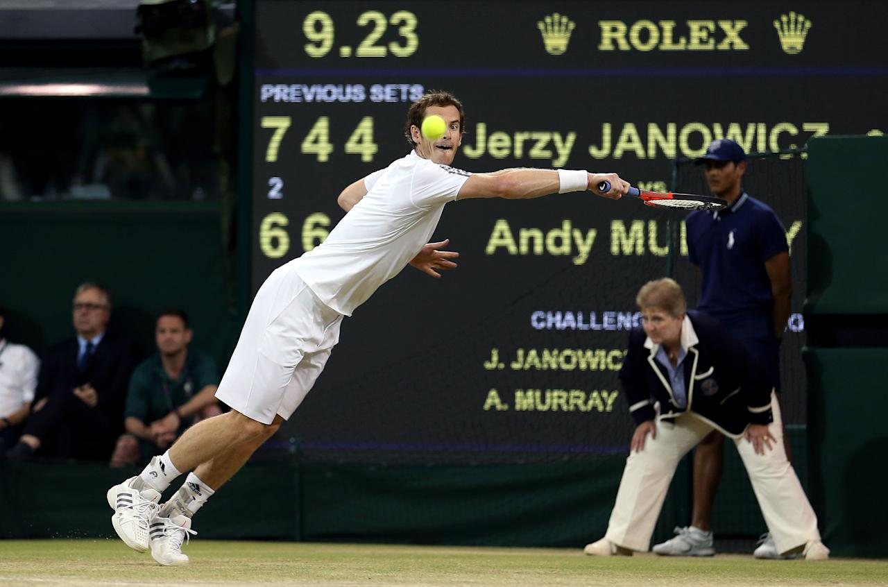 Great Britain's Andy Murray in action against Poland's Jerzy Janowicz during day eleven of the Wimbledon Championships at The All England Lawn Tennis and Croquet Club, Wimbledon.