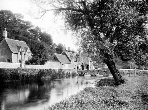 The Cotswolds village of Bibury – with far fewer tourists than you're likely to see today - Credit: Historic England Archive/Heritage Images
