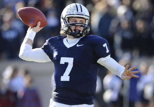 Yale quarterback Henry Furman (7) throws during the first half of an NCAA college football game against Harvard at Yale Bowl, Saturday, Nov. 23, 2013 in New Haven, Conn. (AP Photo/Jessica Hill)
