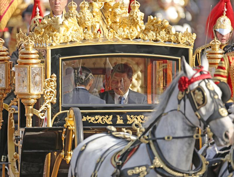 LONDON, UNITED KINGDOM - OCTOBER 20: President of The People's Republic of China, Xi Jinping, rides in the Diamond Jubilee State Coach along The Mall after the ceremonial welcome on Horse Guards Parade for the Chinese President on the first day of his state visit to the UK on October 20, 2015 in London, England. The President of the People's Republic of China, Mr Xi Jinping and his wife, Madame Peng Liyuan, are paying a State Visit to the United Kingdom as guests of The Queen. They will stay at Buckingham Palace and undertake engagements in London and Manchester. The last state visit paid by a Chinese President to the UK was Hu Jintao in 2005. (Photo by Yui Mok - WPA Pool/Getty Images)