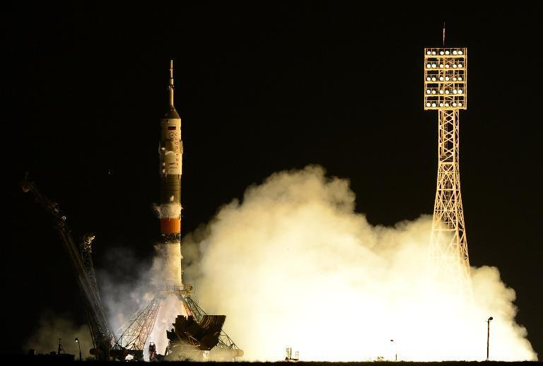 An American and two Russians Thursday boarded the ISS after a journey from Earth, on a mission that will see the Olympic torch for the 2014 Sochi Games taken into space for the first time