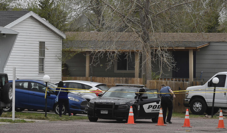 A Colorado Springs police officer goes to help a person who was in a different mobile home to be able to get to her car from behind the crime tape in Colorado Springs, Colo., Sunday, May 9, 2021. A gunman opened fire at a birthday party in Colorado, slaying six adults before killing himself Sunday. Police say the shooting happened just after midnight in a mobile home park on the east side of Colorado Springs. The Colorado Springs Gazette reports officers arrived at a trailer to find six dead adults and a man with serious injuries who died later at a hospital. (Jerilee Bennett/The Colorado Springs Gazette via AP)