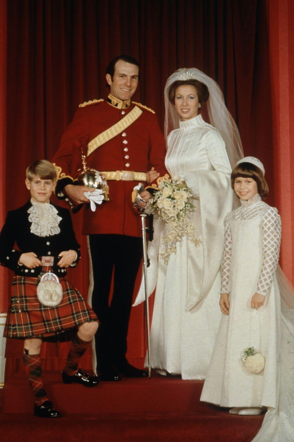 <p>On her wedding day with husband Mark Phillips, younger brother Prince Edward, and cousin Lady Sarah Armstrong-Jones.</p>