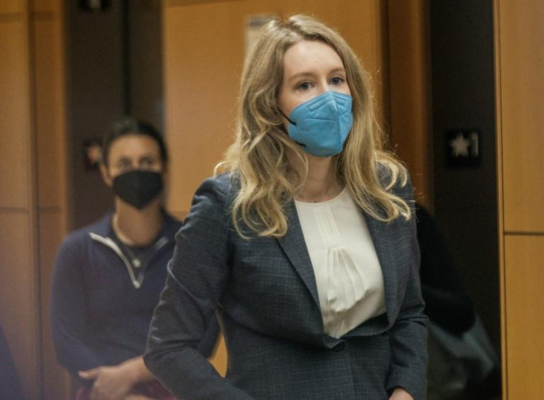 Fallen biotech star Elizabeth Holmes arrives for the first day of her fraud trial in California (AFP/Nick Otto)