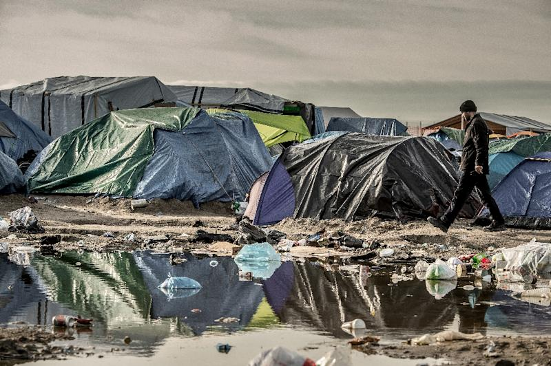 "A man walks past tents on November 5, 2015 in the ""Jungle"" migrant camp in Calais, northern France (AFP Photo/Philippe Huguen)"