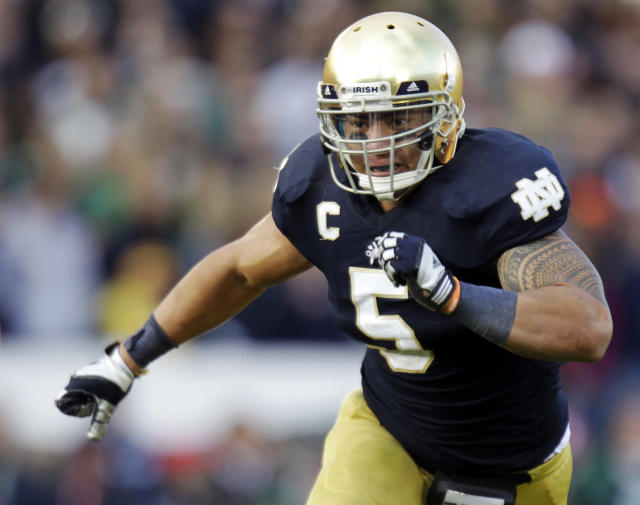 FILE - In this Oct. 20, 2012, file photo, Notre Dame linebacker Manti Te'o chases the action during the second half of an NCAA college football game against BYU in South Bend, Ind. The wrenching story of Te'o's girlfriend dying of leukemia _ a loss he said inspired him to play his best all the way to the BCS championship _ was dismissed by the school Wednesday, Jan. 16, 2013, as a hoax perpetrated against the linebacker. (AP Photo/Michael Conroy, File)