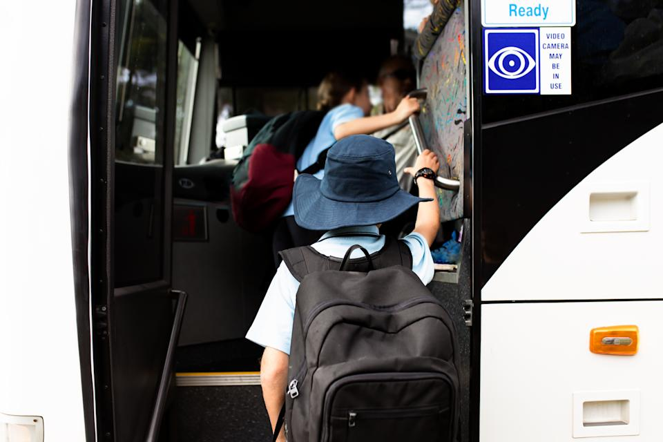 schoolboy boards the a school bus. Source: Getty Images