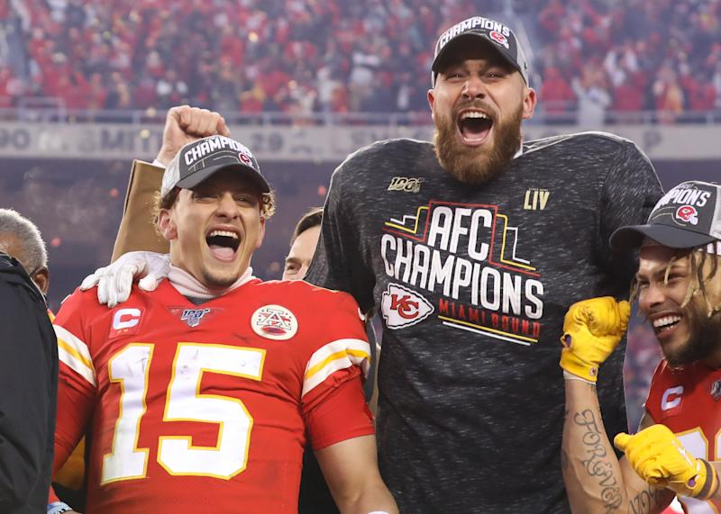 Kansas City Chiefs quarterback Patrick Mahomes (15) and tight end Travis Kelce (87) yell in celebration after the AFC Championship game between the Tennessee Titans and Kansas City Chiefs on January 19, 2020 at Arrowhead Stadium in Kansas City, MO. (Photo by Scott Winters/Icon Sportswire via Getty Images)