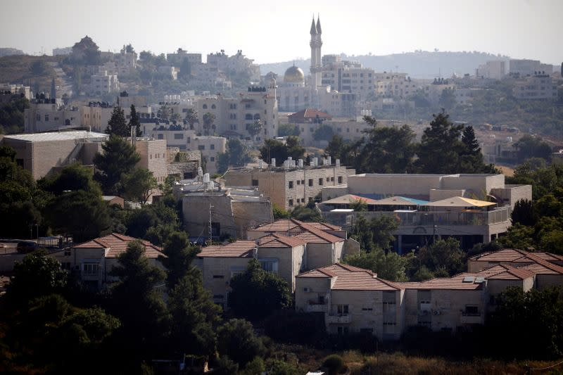FILE PHOTO: A general view shows part of the Jewish settlement of Beit El in the forground near Ramallah in the Israeli-occupied West Bank