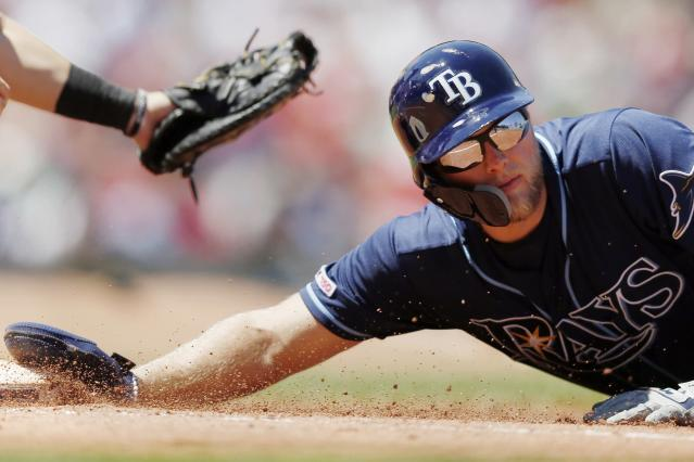 Tampa Bay Rays' Austin Meadows, right, avoids the pickoff attempt at first base by Boston Red Sox's Michael during the second inning in the first baseball game of a doubleheader in Boston, Saturday, June 8, 2019. (AP Photo/Michael Dwyer)