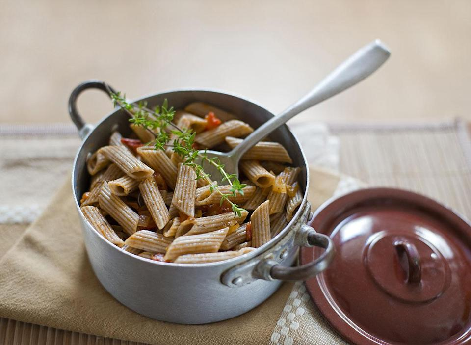 cooked and seasoned whole wheat pasta in pan