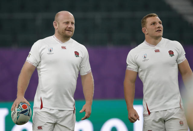 England's Dan Cole, left, and Sam Underhill attend a training session in Oita, Japan, Friday, Oct. 18, 2019. England will face Australia in the quarterfinals at the Rugby World Cup on Oct. 19. (AP Photo/Christophe Ena)