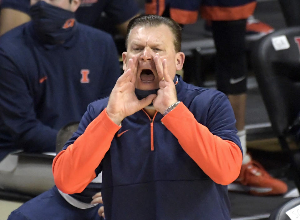 Illinois head coach Brad Underwood shouts instructions during the first half of an NCAA college basketball game against Rutgers, Sunday, Dec. 20, 2020, in Piscataway, N.J. (AP Photo/Bill Kostroun)