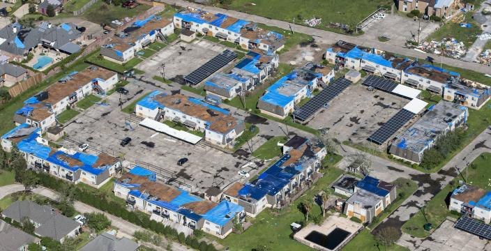 Blue tarps cover houses in the aftermath of Hurricane Delta, Saturday Oct. 10, 2020, in Lake Charles, La. (Bill Feig/The Advocate via AP, Pool)