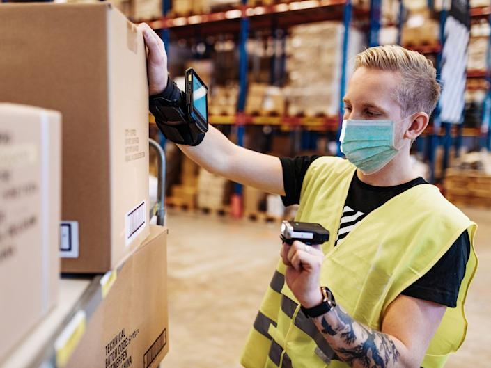 A warehouse worker scans a box