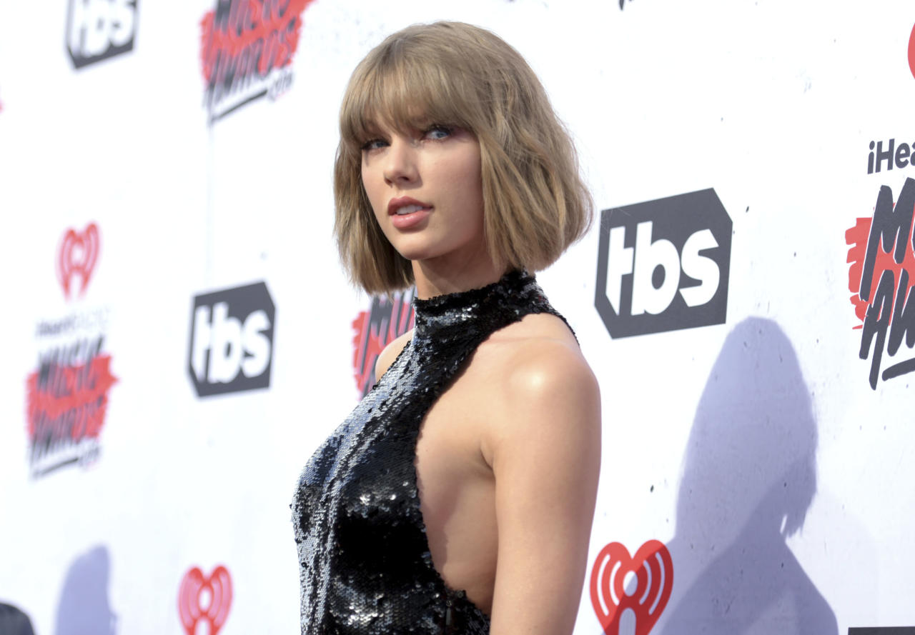 """<p> FILE - In this April 3, 2016 file photo, Taylor Swift arrives at the iHeartRadio Music Awards in Inglewood, Calif. In just four days, Swift's new album has sold more traditional albums than any other release this year. Billboard reports that """"reputation"""" has sold 1.05 million copies in the first four days of its release. The album came out on Nov. 10. (Photo by Richard Shotwell/Invision/AP, File) </p>"""