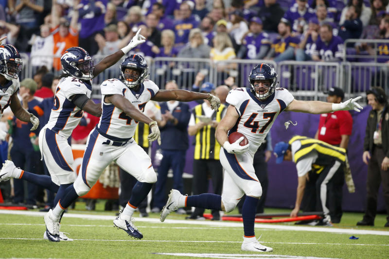 Denver Broncos' Josey Jewell (47) celebrates with teammates after recovering a fumble by Minnesota Vikings' Ameer Abdullah during the first half of an NFL football game, Sunday, Nov. 17, 2019, in Minneapolis. (AP Photo/Bruce Kluckhohn)