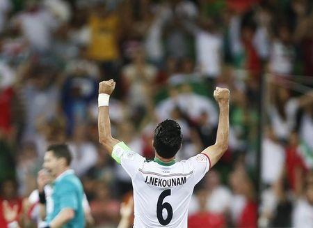Iran's Javad Nekounam celebrates the team's win over Bahrain after the Asian Cup Group C soccer match at the Rectangular stadium in Melbourne January 11, 2015. REUTERS/Brandon Malone
