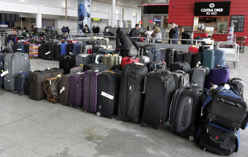 The Latest: JFK airlines told to get bags to owners faster