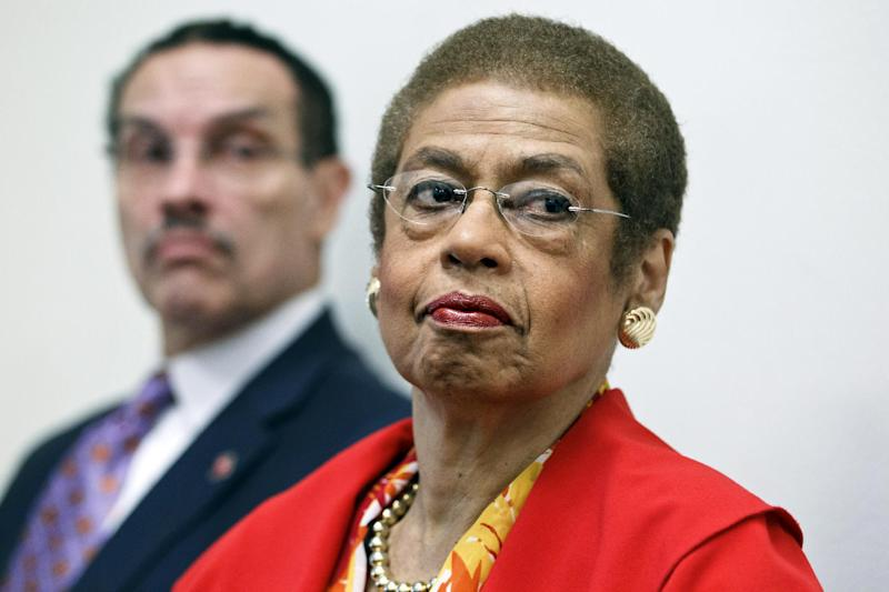 FILE - In this May 29, 2012 file photo, Del. Eleanor Holmes Norton, D-D.C., a non-voting delegate in the House of Representatives, right, accompanied by Washington Mayor Vincent Gray, take part in a news conference on Capitol Hill in Washington.  Some District of Columbia leaders say they're disappointed that President Barack Obama hasn't been more of an advocate for local autonomy in his first term. Obama carried the district in 2008 with 92 percent of the vote, an unusually high percentage even in this overwhelmingly Democratic city. The president also hasn't appeared in public with Mayor Vincent Gray since the mayor took office. The mayor's 2010 campaign is the subject of a wide-ranging federal investigation.   (AP Photo/J. Scott Applewhite, File)