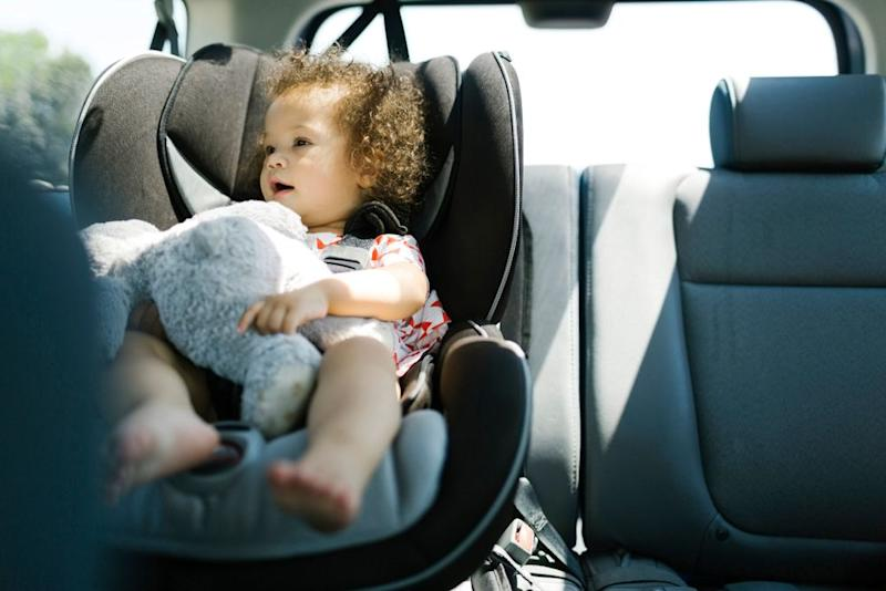 Child in car seat | Getty
