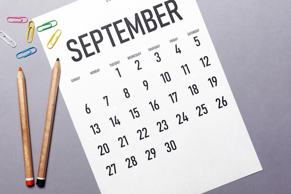 September 2020 simple calendar with office supplies and copy space