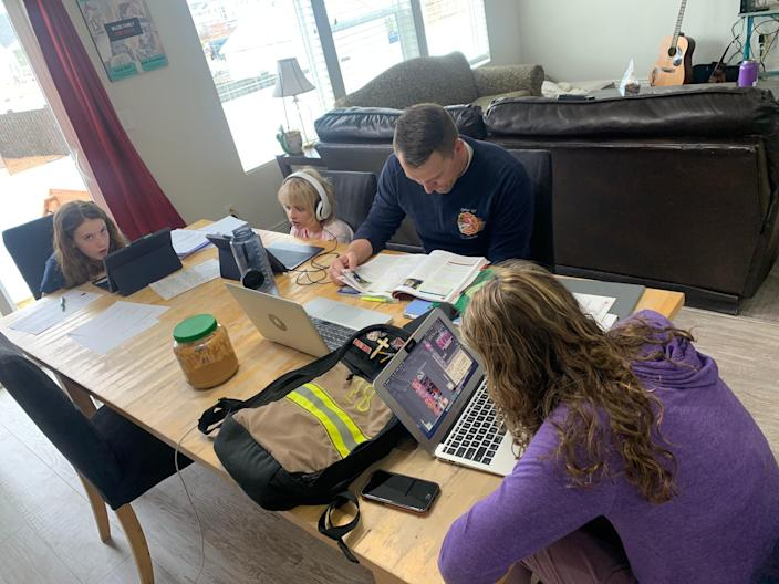 """Amelia Wilcox and her family's """"before"""" photo, all crowded around their kitchen table in Heber City, Utah."""