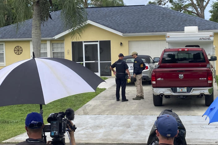 Officials investigate the home of Brian Laundrie in North Port, Florida, on September 20, 2021. / Credit: Curt Anderson / AP