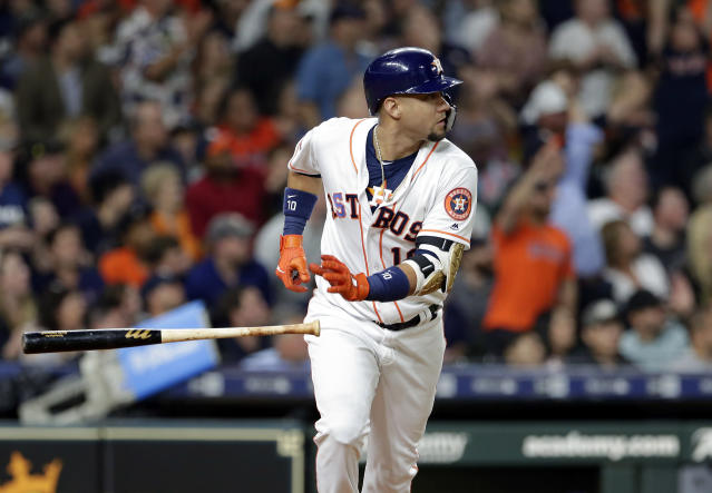 Houston Astros' Yuli Gurriel flips his bat as he rounds the bases on his two-run home run during the fifth inning of a baseball game Wednesday, Sept. 18, 2019, in Houston. (AP Photo/Michael Wyke)