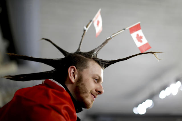 <p>A spectator wearing the Canada flag on his hair watches the mixed doubles semi-final curling match between Russian athletes and Switzerland at the 2018 Winter Olympics in Gangneung, South Korea, Monday, Feb. 12, 2018. (AP Photo/Natacha Pisarenko) </p>