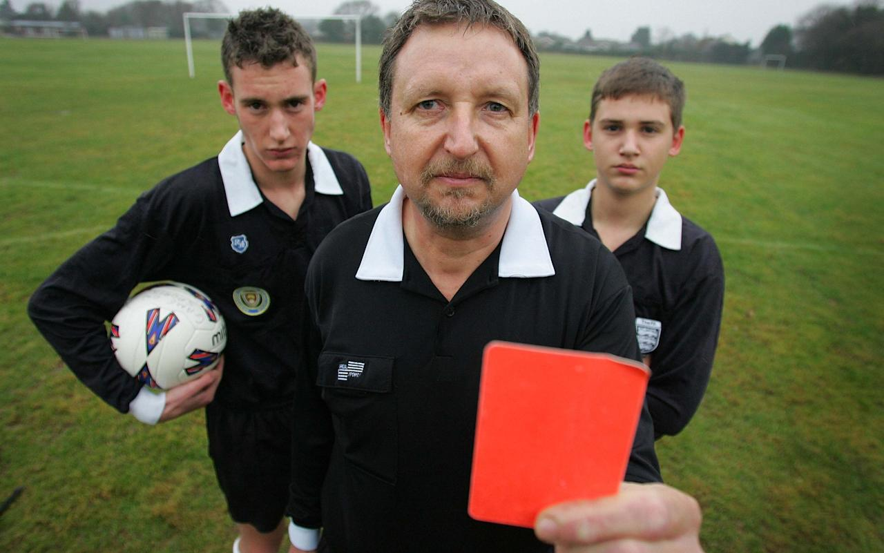 "The Football Association have introduced a series of tough new mandatory bans for grassroots players who abuse referees following a strike last season of officials and a Telegraph campaign for action. In a series of rule changes that will come into force for the 2017-18 season, players at all grassroots and youth levels will now receive an automatic and minimum five-year ban from football if they assault a referee. There will also be at least an 84-day ban and £100 fine for any physical contact with a match official. Verbal threats will now be sanctioned with a minimum ban of 56 days, or six matches, and a fine of £50. County FAs have all been written to by the national governing body and told that disciplinary commissions must impose these sanctions and can further increase them based on any aggravating factors. The FA did previously have a series of recommendations for the punishment of serious misconduct but these were not mandatory and, as extensively reported by The Telegraph, many grassroots referees felt both endangered and unsupported. Referee Ryan Hampson, an 18-year-old Manchester-based referee, was among those to reveal how he had been physically attacked and verbally intimidated in a series of horrific incidents that included being head-butted, spat at, punched and even barricaded into a changing room after a match. He launched a campaign that was backed by hundreds of other referees and culminated in a national strike of grassroots officials earlier this year. Hampson also met with Nathan French, the FA's newly-appointed Respect manager, to outline his suggestions and believes that the national governing body really is now listening and initiating significant change. ""The mandatory bans are a massive step forward and I am sure they will be welcomed by referees across the country,"" said Hampson. ""The situation for many referees had got desperate. The abuse was out of hand and, while not everyone agreed that striking was the right way forward, I am so happy that real change has followed the campaign. These new sanctions will give reassurance to referees to know that they are being backed up and that we were not punch-bags. Ryan Hampson had been head-butted, spat at and punched Credit: PAUL COOPER ""The Telegraph also made a huge difference in highlighting my story and the whole issue. People have really started listening to what we had to put up with. I am enjoying my refereeing again and I can't wait for the new season."" The Telegraph had previously revealed research by universities at Loughborough, Portsmouth and Edge Hill that showed 94 per cent of football referees had experienced verbal abuse and one in five have been the victims of a physical attack. Academics had also found similarly alarming trends developing in rugby and cricket. The FA were accused of allowing their Respect campaign to run out of steam following its launch in 2008 but a dedicated Respect Manager role was reinstated late last year. French began work shortly before the strike in March and has made significant strides both in revitalising the Respect campaign and gaining the confidence of referees. As well as the new mandatory bans, the FA are trialling sin-bins next season in 32 grassroots leagues. Players will now spend 10 minutes out of the game if they are shown a yellow card for dissent, with various men's, women's, youth, Saturday and Sunday league taking part in the pilot. The FA are trialling sin-bins next season in 32 grassroots leagues Credit: JAMES BOARDMAN One of those is the Surrey Youth League, whose chairman Graham Ekins had warned last year of a potential fatality following a weekend of matches when allegations ranged from a parent threatening to stab a referee, abuse of a child referee, a touchline fight between parents, a linesman being head-butted and young players being encouraged to destroy a changing room. Ekins has since overseen a series of changes that inspired a dramatic improvement in behaviour and, last week, the Surrey Youth League was named national league of the year in the FA's annual Respect awards. They were also the winners of the National Charter Standard League. Ekins has also met with French to discuss how the culture-change was achieved and is also impressed by the FA's current proactive stance. Among the initiatives in Surrey was to ensure every player, manager and parent signed a code of conduct at the start of the season. Respect marshals were also introduced to work as a conduit between referees and teams to prevent low-level issues escalating and to ensure that clubs were notified if there were concerns about the behaviour of any parent, player or coach. Significantly, supporters are also now prohibited from standing on the touchline behind either linesman during a match. ""The changes have made a huge difference and shows how you can make improvements if you galvanise everyone,"" said Ekins. ""To go from where we were to where we are now is fantastic. I am so proud."""