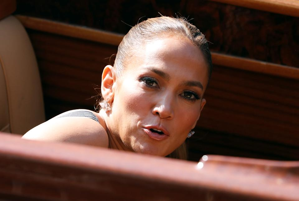 Jennifer Lopez leaves with Ben Affleck (not pictured) after a photo call and news conference for the film