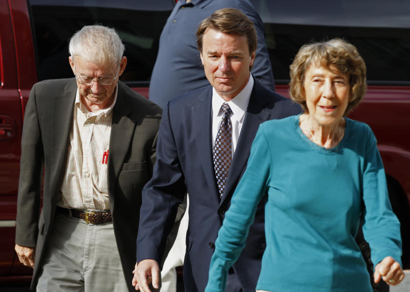 John Edwards, center, arrives at a federal courthouse with his mother Bobbie Edwards, right, and his father Wallace Edwards, left, for the seventh day of jury deliberations in his trial on charges of campaign corruption in Greensboro, N.C., Tuesday, May 29, 2012.  Edwards, the former U.S. presidential candidate, faces six felony charges in a case involving nearly $1 million provided by two political donors to help hide the Democrat's pregnant mistress as he sought the White House in 2008. (AP Photo/Chuck Burton)