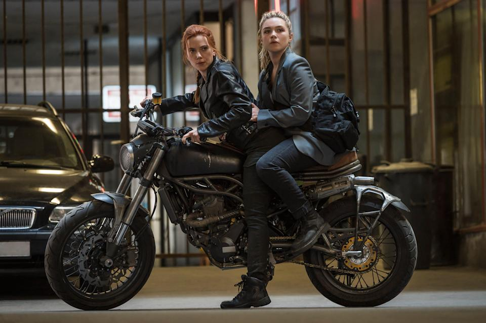 """Natasha Romanoff (Scarlett Johansson, left) reconnects with her younger sister Yelena Belova (Florence Pugh) in """"Black Widow."""""""