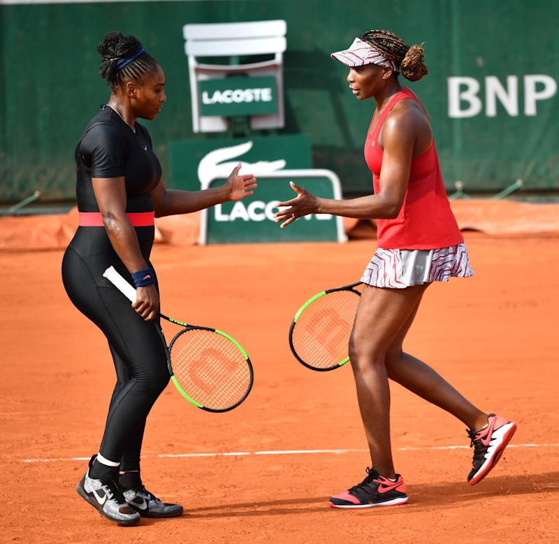 PARIS, FRANCE - JUNE 03: Venus Williams (R) and Serena Williams (L) of the USA in action against Andreja Klepac (not seen) of Slovenia and Maria Jose Martinez (not seen) Sanchez of Spain during during their ladies doubles fourth round match at the French Open tennis tournament at Roland Garros Stadium in Paris, France on June 03, 2018. (Photo by Mustafa Yalcin/Anadolu Agency/Getty Images)