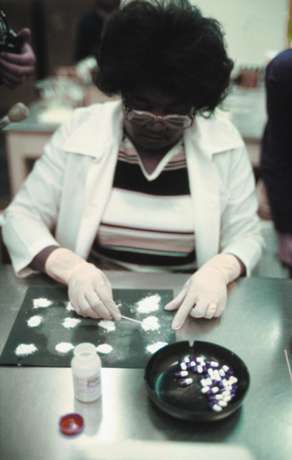 Lab technician testing Tylenol capsules. Source: Getty Images
