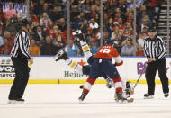 Officials watch as Florida Panthers center Micheal Haley (18) takes down Buffalo Sabres center Jordan Nolan during a fight in the first period of an NHL hockey game, Friday, March 2, 2018, in Sunrise, Fla. (AP Photo/Wilfredo Lee)