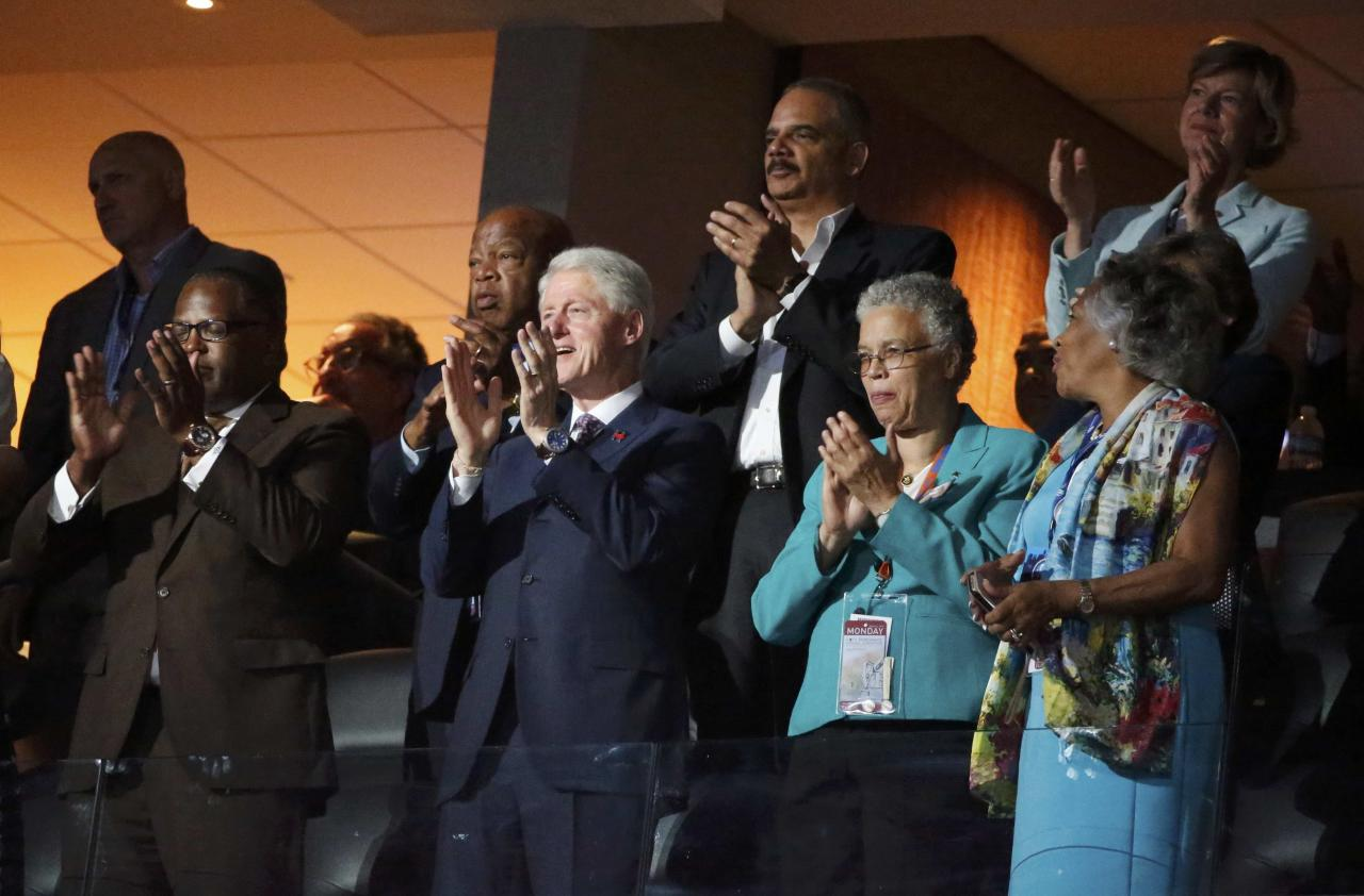 Former President Bill Clinton applauds First Lady Michelle Obama's speech at the Democratic National Convention in Philadelphia, Pennsylvania, U.S. July 25, 2016. REUTERS/Lucy Nicholson