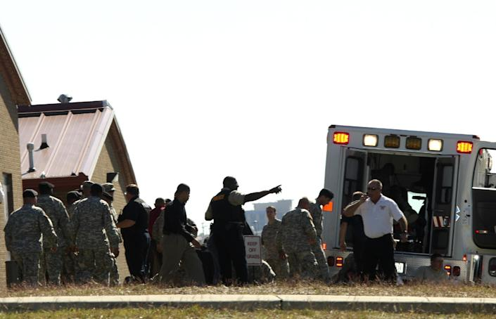 FILE- In this Nov. 5, 2009, file image released by the U.S. Army, emergency workers prepare the wounded for transport in waiting ambulances near Fort Hood's Soldier Readiness Processing Center in Fort Hood, Texas. Maj. Nidal Hasan is charged in the 2009 shooting rampage at Fort Hood that left 13 dead and more than 30 others wounded. Hasan doesn't deny that he carried out the rampage, but military law prohibits him from entering a guilty plea because authorities are seeking the death penalty. If he is convicted and sentenced to death in a trial that starts Tuesday, Aug. 6, 2013, there are likely years, if not decades, of appeals ahead. (AP Photo/U.S. Army, Jeramie Sivley, File)