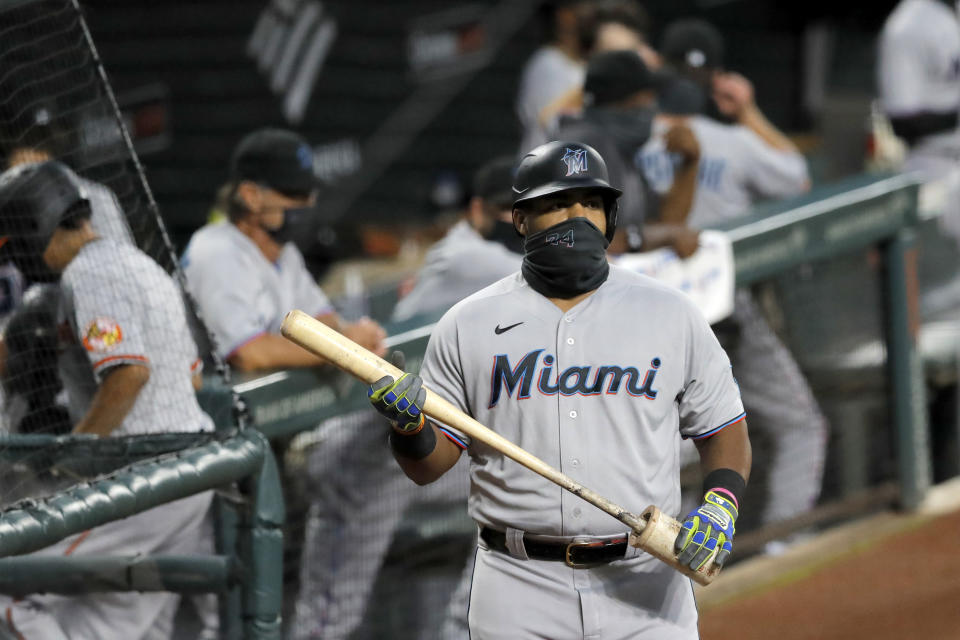 Miami Marlins' Jesus Aguilar wears a face mask to protect against COVID-19 as he stands at the on deck circle during the first inning of a baseball game against the Baltimore Orioles, Tuesday, Aug. 4, 2020, in Baltimore, Md. (AP Photo/Julio Cortez)